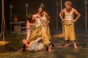 Antigone (Kaya Bucholc) held by Guard (Eric Mrakovcic) as Guards (Renee Awotwi & Patrick Fowler) look on